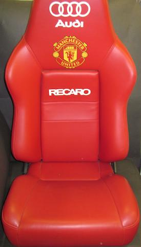 A Manchester United Old Trafford 'dug out' chair