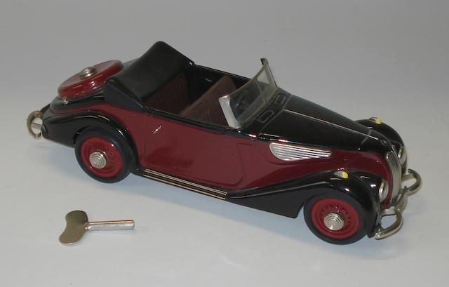 A tin-plate BMW 327 Cabriolet clockwork toy, by Schuco,