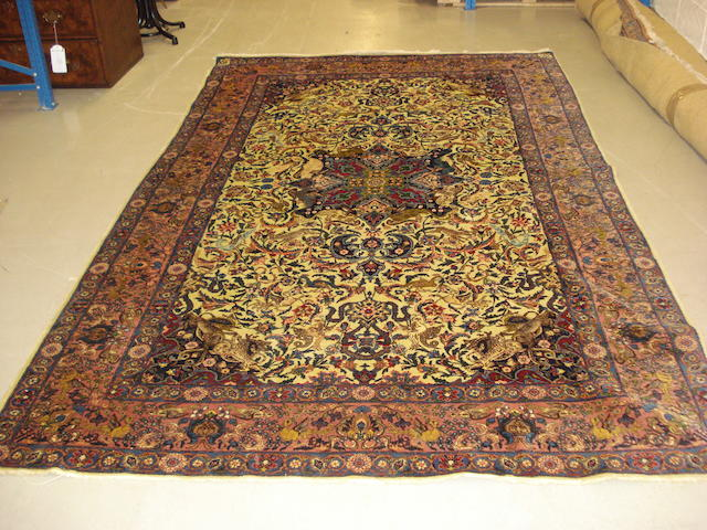 A Kirman carpet, South East Persia, 296cm x 186cm, signed