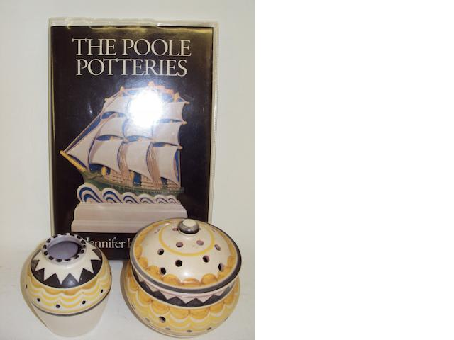 A Poole pot pourri pot and cover, a matching vase, and a Jennifer Hawkins Poole book