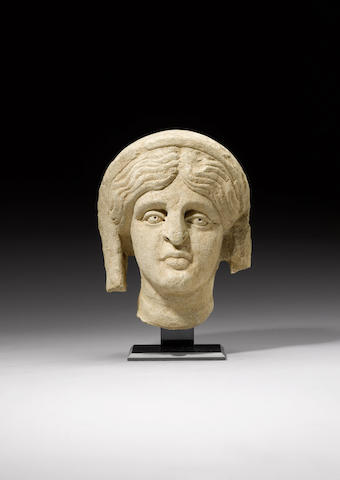 A Roman limestone female head