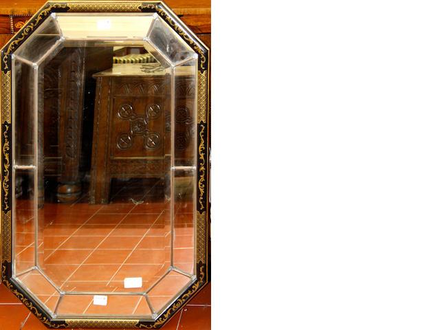 A modern laquered octagonal mirror,
