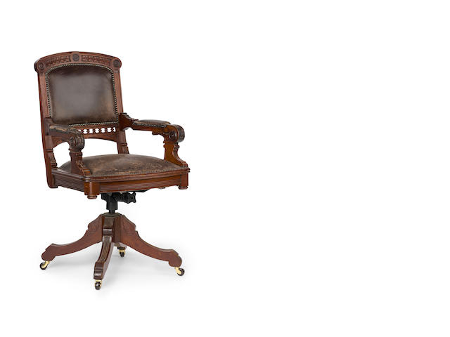 An early 20th century Australian cedar and upholstered desk chair