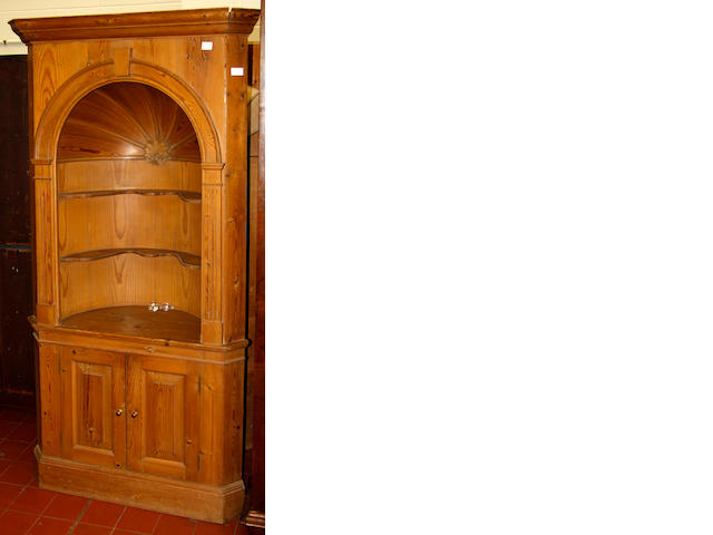 A pair of Georgian style pine corner alcoves