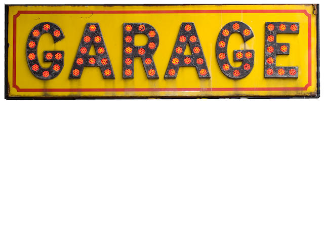 A large enamel 'GARAGE' sign by Fairylite signs of London,