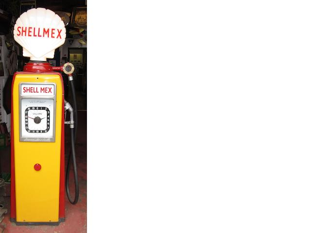An Avery-Hardoll clock face petrol pump,