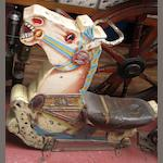 A fairground ride painted wooden horse,