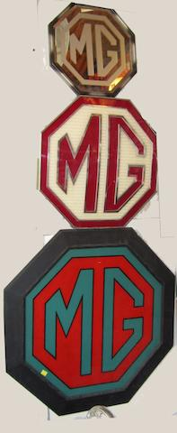 Three MG signs,