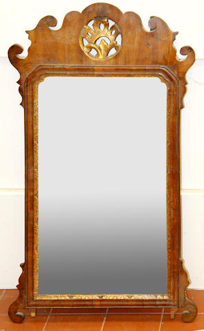 A late 18th Century walnut fret frame mirror,