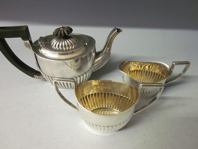 A silver three piece tea service, Birmingham 1902,  (3)