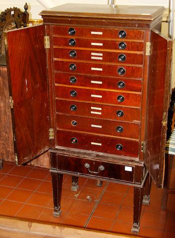 A mahogany silver cabinet, a chiffonier and a wall mirror.