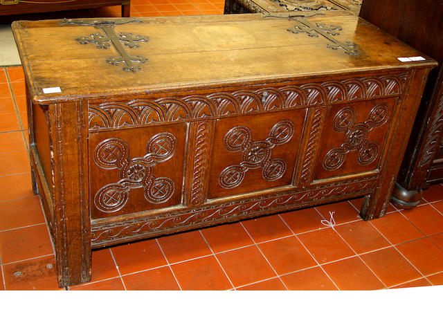 A late 17th/early 18th Century panelled oak coffer,