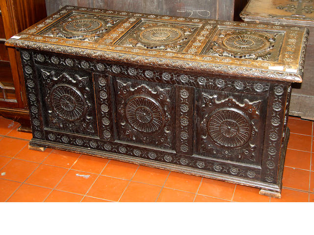 A carved and panelled oak coffer, 2nd half 19th Century,