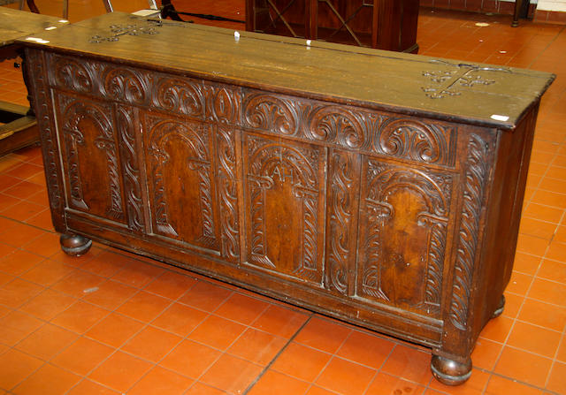 An Antique oak boarded and panelled coffer,