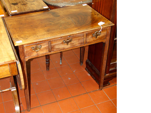 A George III mahogany three-drawer side table,
