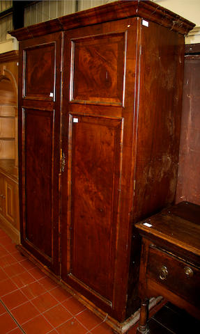 An 18th Century style walnut veneered double wardrobe,