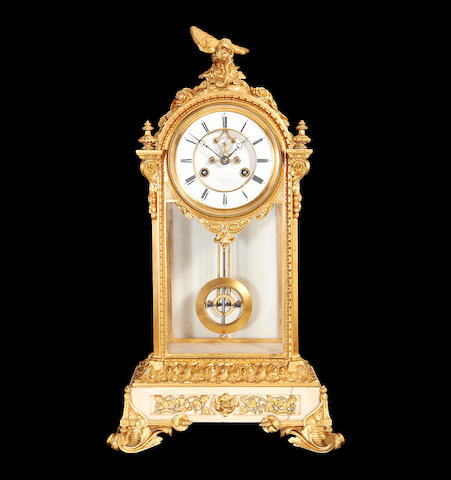 A late 19th century French gilt metal, marble and glass mantel clockby Henry Marc, Paris