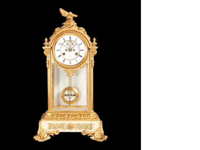 A late 19th century French gilt metal marble and glass mantel clock by Henry Marc, Paris