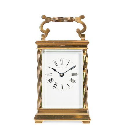 An early 20th century French lacquered brass 'twisted column' carriage clockRetailed by Mappin & Webb, London