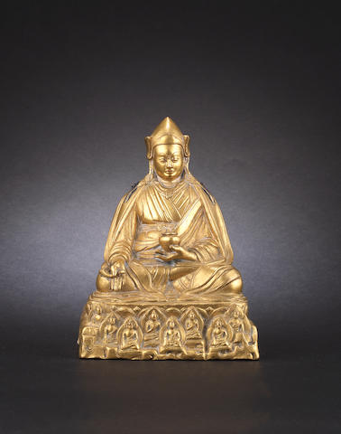 A gilt-bronze figure of a Lama  Probably 18th century