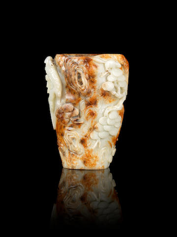 A pale green and russet jade 'pine-trunk' brushpot, bitong 17th/18th century