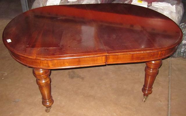 A large Victorian mahogany extending dining table,