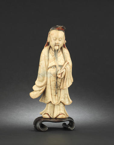 A stained soapstone carving of a standing scholar 17th or 18th century