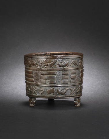 A bronze circular incense burner or ding Ming Dynasty