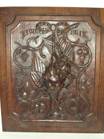Four late 19th century carved oak panels