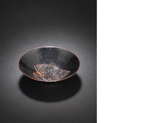 A black-glazed conical tea bowl