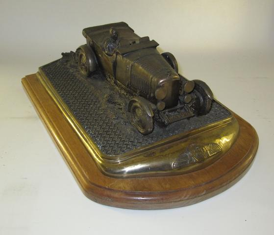 A Bentley 4½ Litre Le Mans bronze sculpture by Chris Davis,