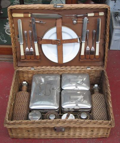 A 4-person wicker picnic basket,