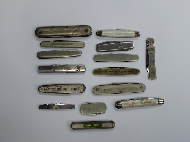 A collection of promotional pen knives,