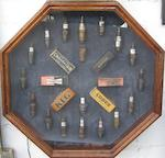 A pair of glazed spark plug displays,