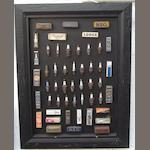 A framed display of spark plugs and containers,