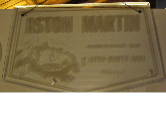 An Aston Martin commemorative hanging glass sign,