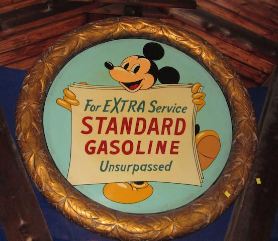 A Standard Gasoline commemorative roundel featuring Mickey Mouse,