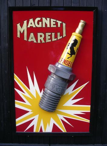 A Magneti Marelli Ferrari spark plug sign,