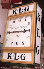 A large KLG illuminated hanging clock, movement by Smith Electric,