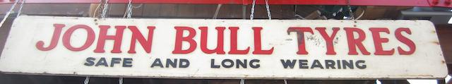 A large John Bull Tyres wooden sign,