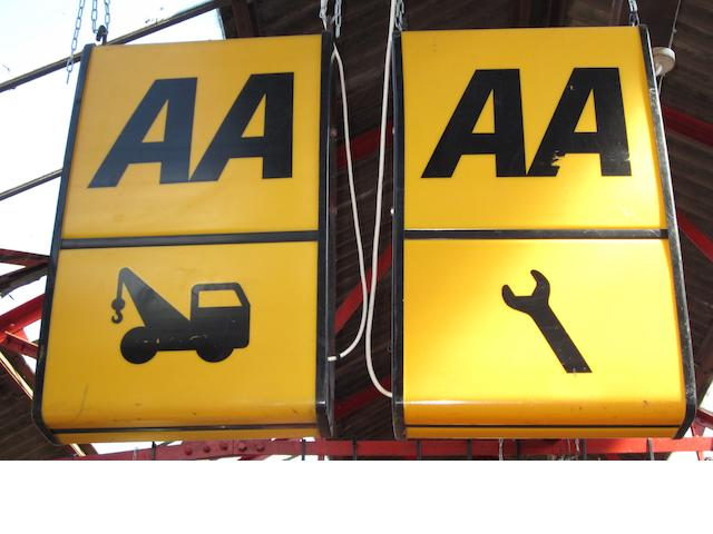 Three illuminated AA signs,