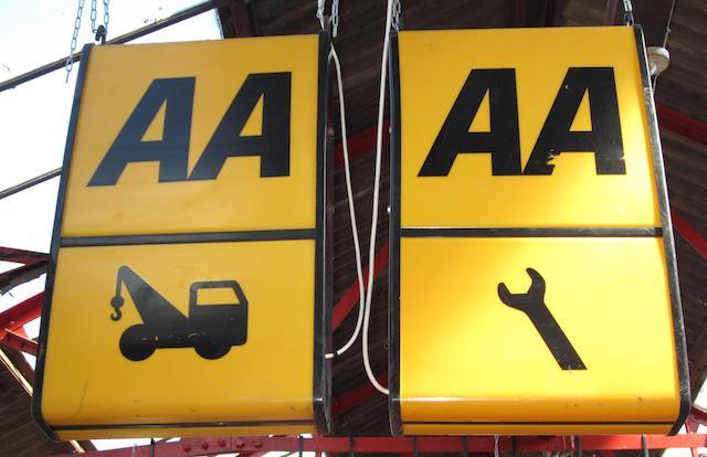 Three illuminated AA signs,