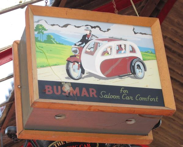 A Busmar Sidecars illuminated sign,