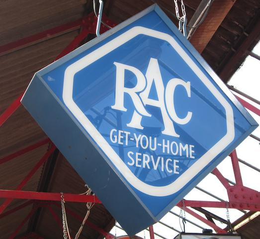 An 'RAC Get-You-Home Service' hanging illuminated sign,