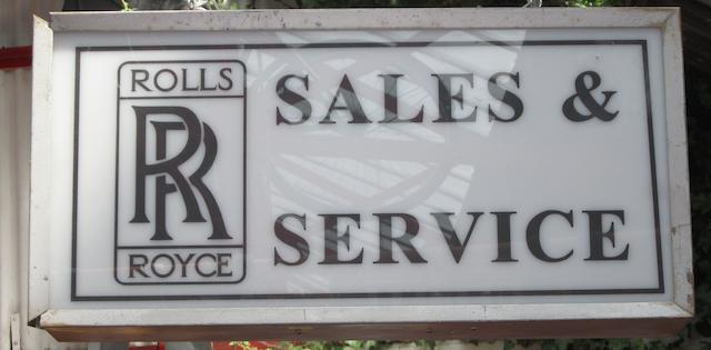 A 'Rolls-Royce Sales and Service' illuminated box sign,