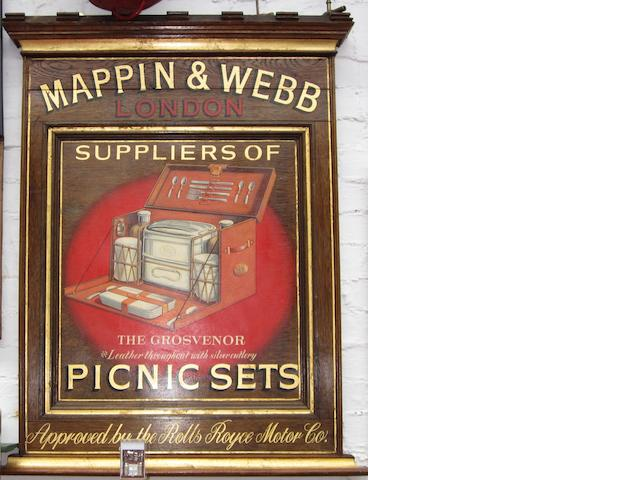 A hand-painted wooden plaque advertising Mappin & Webb picnic sets,