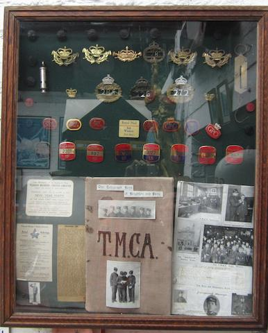 A framed display of GPO Post Office and Royal Mail badges and ephemera,