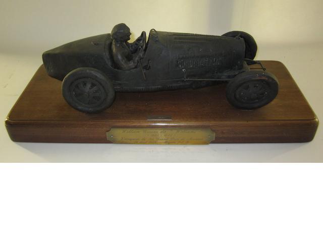 A bronze sculpture of William Grover's Bugatti type 35B,