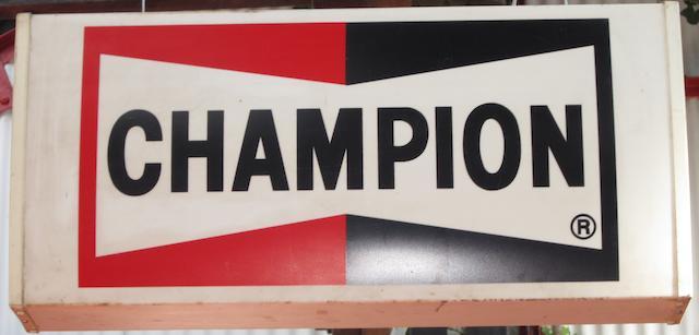 A Champion hanging illuminated sign,