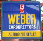 A Weber Carburettors Authorized Dealer illuminating hanging sign,